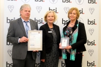 Directors Ted and Clare Dunican receiving BSI award for ISO 9001:2008